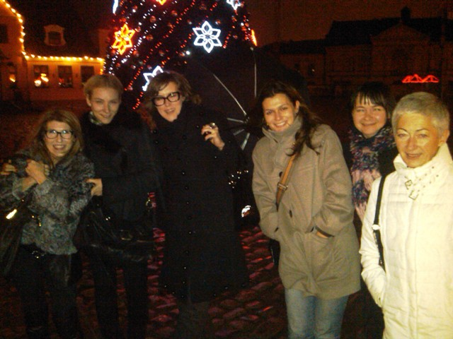 From left to right: Patty Tobin, Yurga Lago and friends, Agla, Ruta, Nika, and Diva, at tree lighting in Klaipeda.